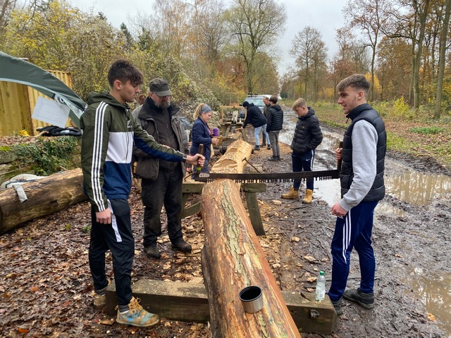 West Suffolk College Students sawing timber